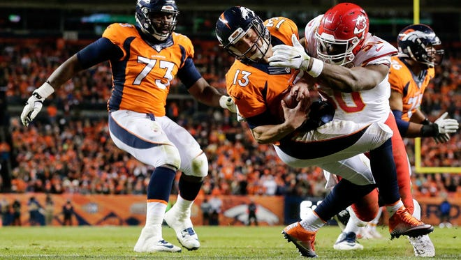 Nov 27, 2016; Denver, CO, USA; Kansas City Chiefs outside linebacker Justin Houston (50) forces a fumble against Denver Broncos quarterback Trevor Siemian (13) in the second quarter at Sports Authority Field at Mile High.