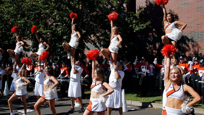 Oregon State cheerleders  perform before an NCAA college football game in Corvallis, Ore., Saturday, Sept. 19, 2015