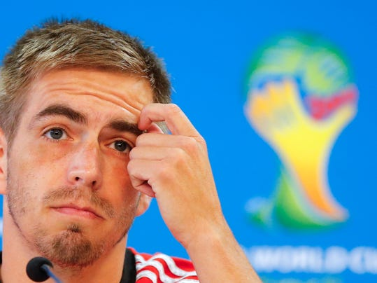 Germany's soccer team player Philipp Lahm listens during a press conference at the Estadio Beira-Rio Stadium in Porto Alegre, Brazil, Sunday, June 29, 2014. Germany will play Algeria in a World Cup round of 16 soccer match on June 30. (AP Photo/Frank Augstein)