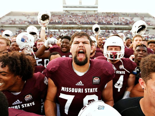 Missouri State Bears offensive lineman Aaron Clardy (79) celebrates with his teammates after the end of the Missouri Valley Conference game between the Missouri State Bears and the Southern Illinois Salukis at Robert W. Plaster Stadium in Springfield, Mo. on Oct. 29, 2016. The Missouri State Bears won the game 38-35.