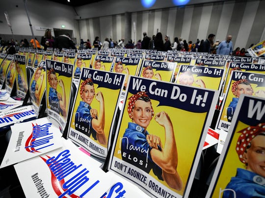 Posters featuring House Minority Leader Nancy Pelosi of Calif. sit on chairs during at the 2018 California Democrats State Convention Saturday, Feb. 24, 2018, in San Diego. (AP Photo/Denis Poroy)