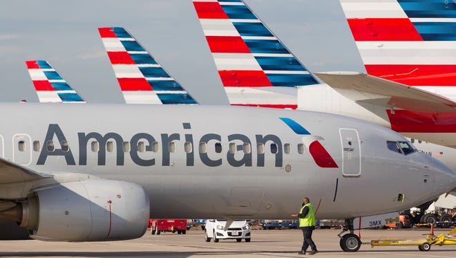 American Airlines jets sit ready for departure from Dallas/Fort Worth International Airport on Oct. 14, 2016.