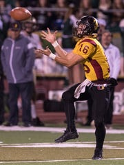 Tulare Union's Matthew Dias takes a pass from Nathan Lamb before scoring against Garces Memorial in a Central Section Division II semifinal high school football game on Friday, November 17, 2017.