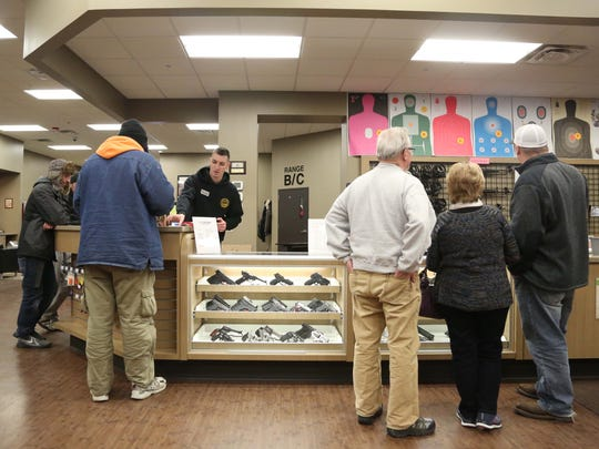 People sign-up for time on the shooting range at CrossRoads Shooting Sports on Sunday, Jan. 10, 2016, in Johnston.