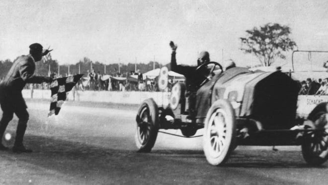 Hoosier Joe Dawson takes the checkered flag as the winner of the 1912 Indianapolis 500.  Dawson had been a distant second during most of the race behind Ralph DePalma.  However, when DePalma's engine blew Dawson passed him to take the victory.