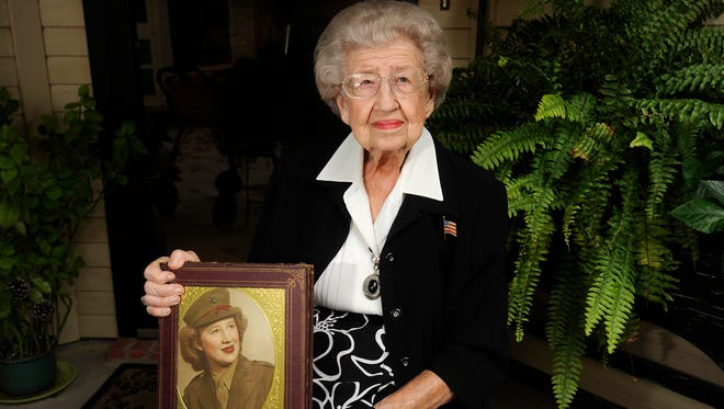 U.S. Marine Corps veteran Ellen Webb displays a photograph of herself from 1945. Webb will serve as grand marshal of the Veterans Day parade Nov. 12 in downtown Abilene.