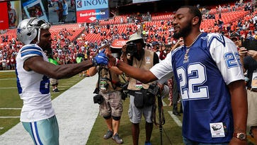 John Wall wears Cowboys jersey to Redskins game