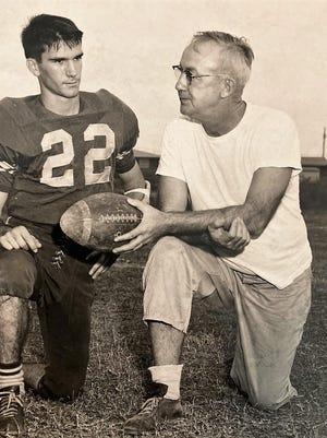 Coach Denny Leonard (right) with player Joe Leonard, (No. 22) no relation.