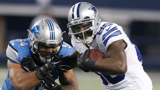Cowboys receiver Dez Bryant gets past Lions linebacker DeAndre Levy in an NFC wild-card playoff game Jan. 4, 2015 in Arlington, Texas.