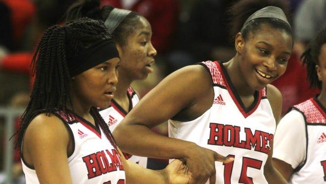 Holmes junior Tyrah Englemon, right, and senior Jaynice Stovall celebrate a basket during a key second half run.