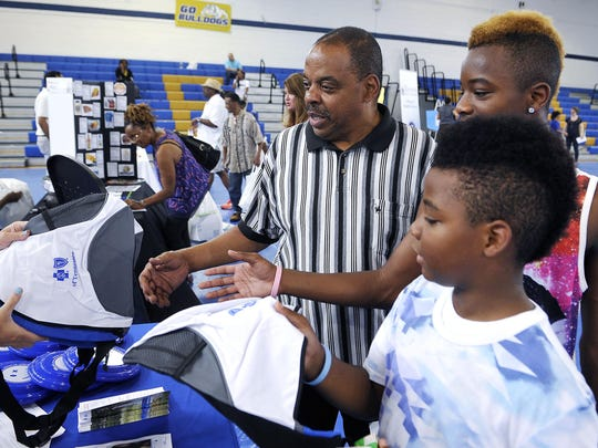 Robert Burton, left, attend the the first Father & Son Health fair for black men at the Fisk University gym on Saturday with his grandsons Jalen Lampkin, center, Gregory Smith. The event was hosted by The Boyz Inc. Saturday June 20, 2015, in Nashville, TN