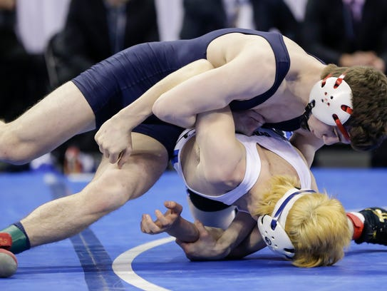 Brookfield Academy's Aidan Medora, top, wrestles against Wrighstown's Ben Durocher in the Division 2 132-pound match against at the WIAA state wrestling championships Feb. 24 in Madison. (Photo © Andy Manis)