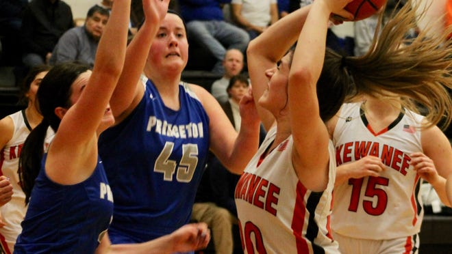 Kewanee's Isabella Tondreau (20) looks for an opening against the Princeton defense.