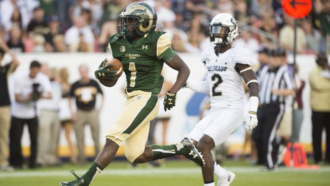 CSU running back Dalyn Dawkins runs into the end zone for a touchdown during the 2015 Rocky Mountain Showdown. The Rams must rely on their rushing attack against the Buffs this season.