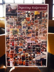 Photo of the poster which shows images taken from places Kathryn and Joseph Schmidt of Ridgewood, who set out 18 months ago to eat at every restaurant, cafe and eatery in Ridgewood, went, is displayed as their friends and supporters gather at Roots Steakhouse in Ridgewood on 05/07/18.