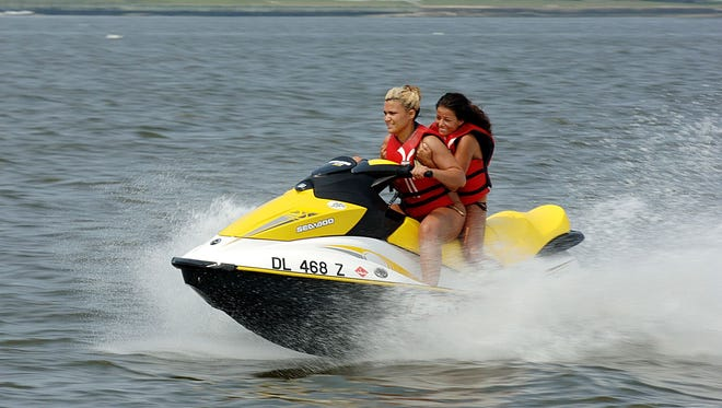 Maureen Mcginnis and Stephanie Angelitto, of Dewey Beach, stay cool on a personal watercraft.