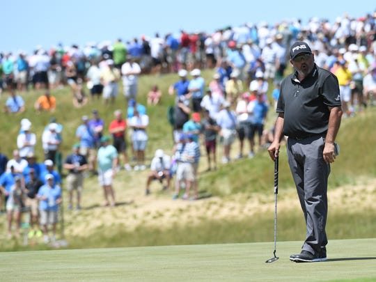Angel Cabrera reacts to his missed putt on the ninth green during the first round of the U.S. Open golf tournament at Erin Hills.