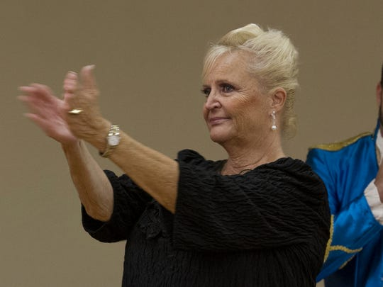Carol Davis, a dance instructor, and event coordinator for the special performance, thanks the crowd for attending Monday afternoon at the Lake Kennedy Senior Center in Cape Coral. Greg Kurth, in background, owner of Rhythm in Motion dance studios, also helped coordinate the event and performed several dances during the presentation.