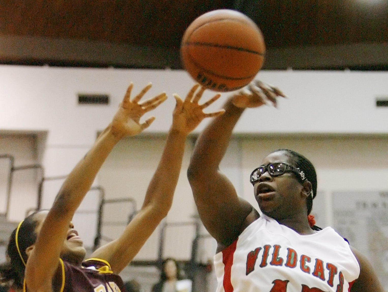 FILE – Felisha Johnson of LN blocks a shot by Brebeuf's A'lahah Newson in the 2006 Marion County girls basketball tournament,