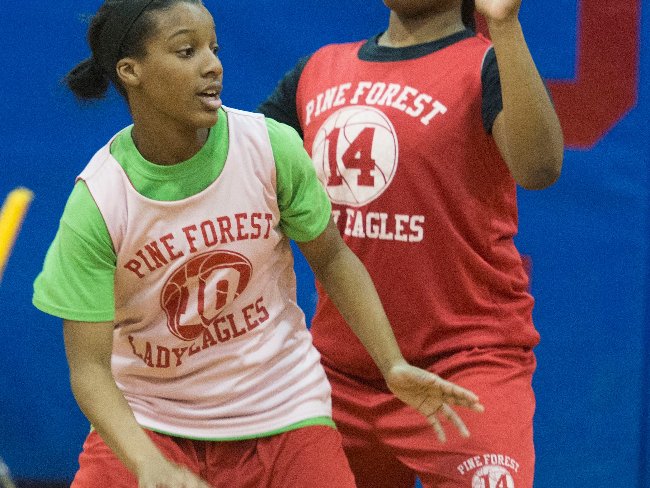 Kendauria Brooks, (No. 10) left, and Quiyana Riley, (No. 14) right, work through drills during practice as The Pine Forest High School girls basketball team prepare for the district 1-6A tournament.