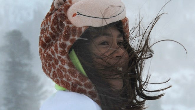 File photo: Rose Williams is buffeted by winds and snow at Tahoe Meadows in 2012.