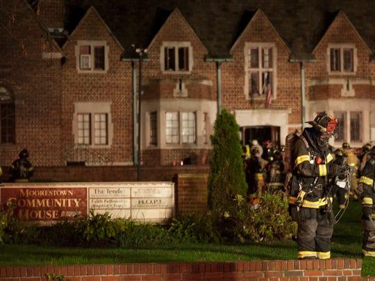 Fire crews respond to a fire at the Moorestown Community House Tuesday evening.  11.17.05