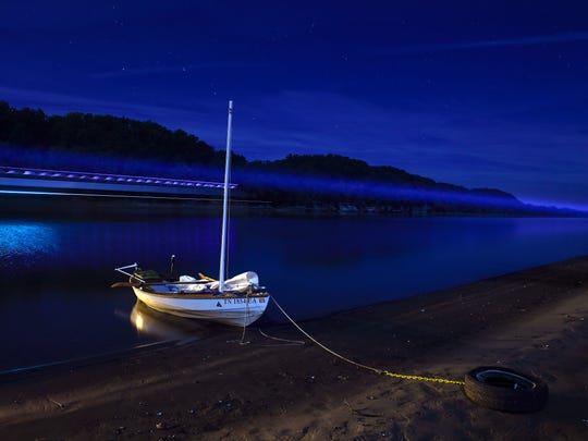 John Guider's boat the Adventure II rests on the bank of the Tennessee River on Oct. 11, 2016, in Parsons, Tenn.