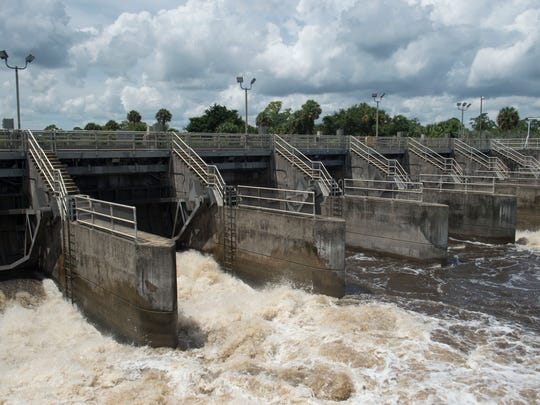 Water from Lake Okeechobee is discharged through the St. Lucie Lock and Dam on Wednesday, Sept. 6, 2017, in Stuart. About 1.1 billion gallons of water was released Sept. 6 with discharges ending Saturday, Sept. 9, before the arrival of Hurricane Irma, according to the Army Corps of Engineers. Discharges started again Friday, Sept. 15, after Irma came through the state.