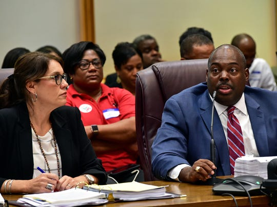 JPS Interim Superintendent Freddrick Murray, right,