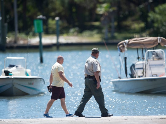 Florida Fish and Wildlife Conservation Commission lieutenant James Fillip and officer David Bingham investigate a two-boat collision on Tuesday, April 3, 2018 near Sandsprit Park in Stuart. An off-duty Martin County Sheriff's deputy heard the crash and assisted the boaters, one of which sustained serious injury.