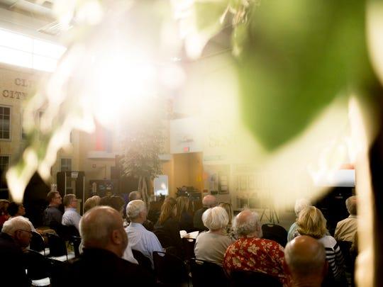 Members of the public attend a public presentation