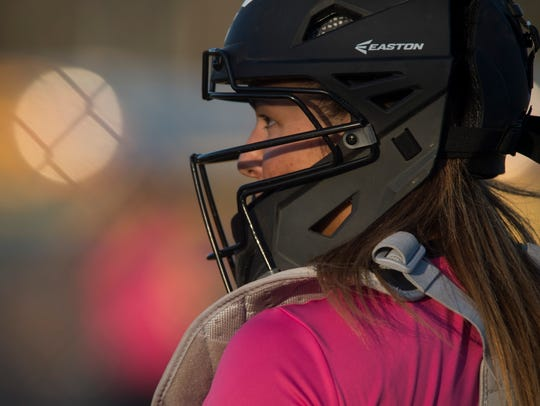 Castle's catcher Jenna Lis (10) looks to her dugout