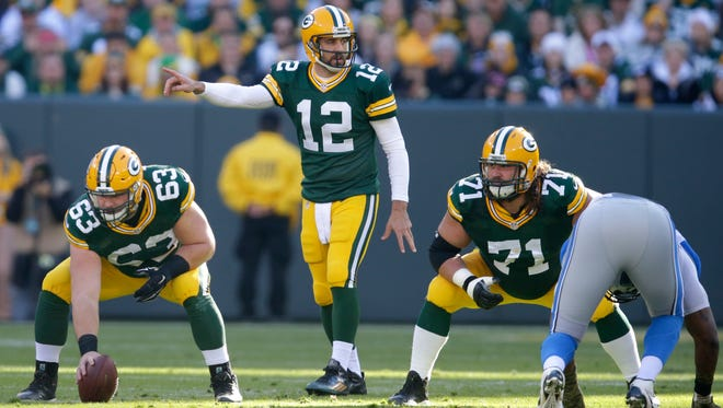 Green Bay Packers quarterback Aaron Rodgers directs the offense against Detroit during the 2015 season.