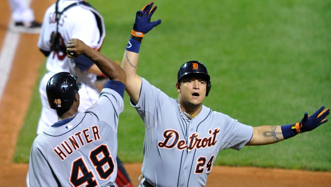 Detroit Tigers third baseman Miguel Cabrera (24) celebrates his two-run home run with right fielder Torii Hunter (48) in the eighth inning against the Cleveland Indians at Progressive Field.