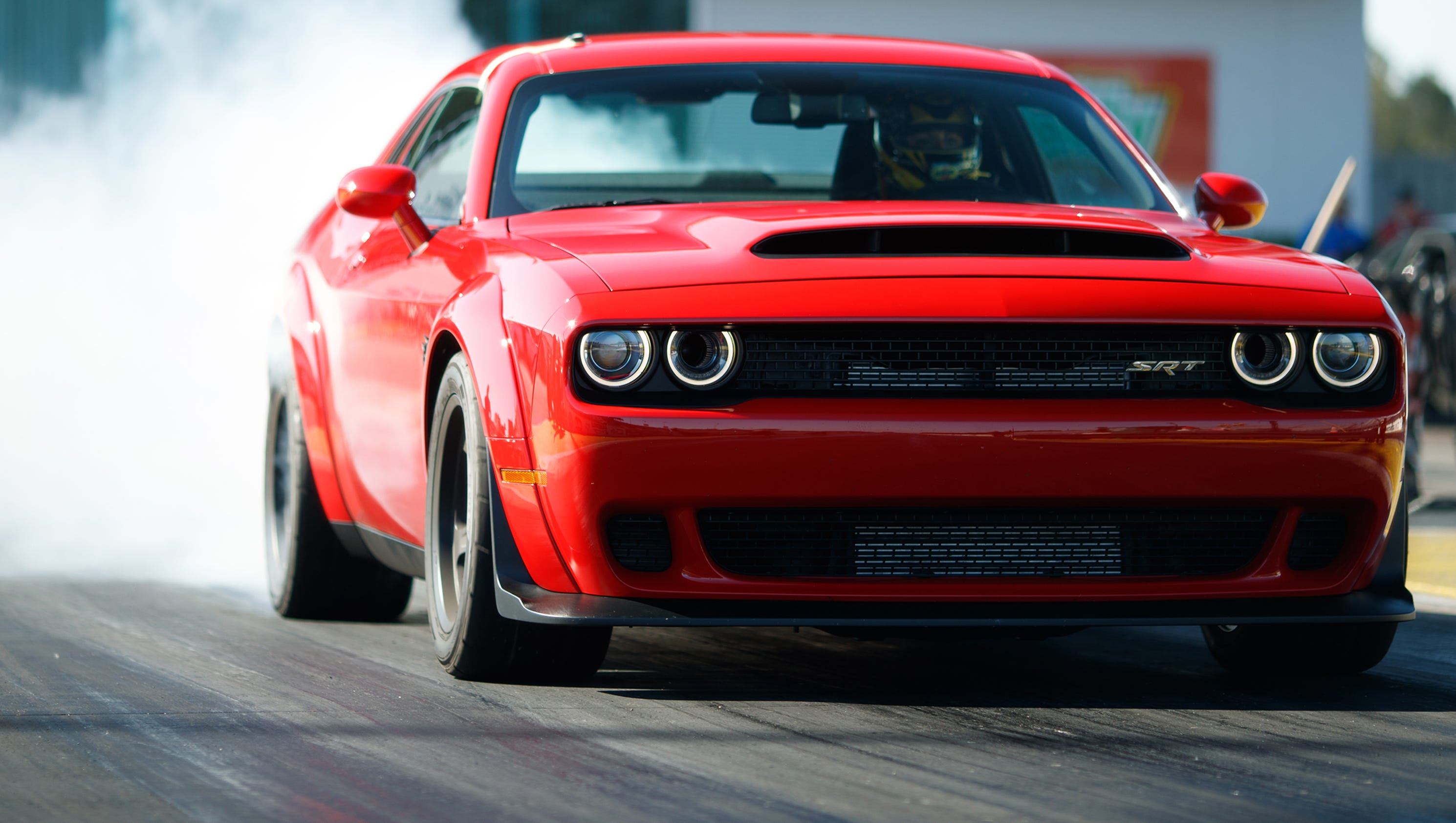 Dodge demon review 840 horsepower car is a slice of for Garage auto 2000 wimille