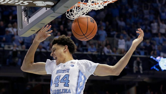 North Carolina's Justin Jackson (44) dunks against Duke during the first half of an NCAA college basketball game in Chapel Hill, N.C., Saturday, March 4, 2017. (AP Photo/Gerry Broome)