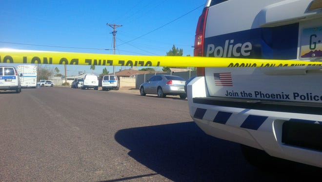 Phoenix police were investigating a crime scene near 18th Street and Roeser Road on Dec. 29, 2014 after a woman was found dead in an alley.