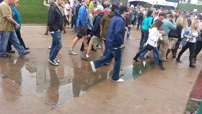 Raw sewage pooled up on the sidewalk near the fan zone at the TPC Scottsdale during Saturday's third round of the Waste Management Phoenix Open.