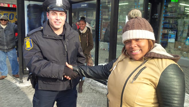 Yonkers police shake hands with residents as part of Stop and Shake campaign.