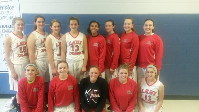The Lady Xplosion ninth grade basketball team.