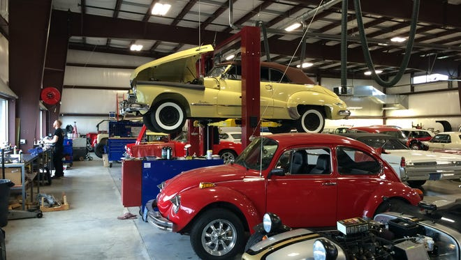 A 1948 Buick and 1975 Super Beetle are in for work at Classic Mechanics in the Town of Menasha.