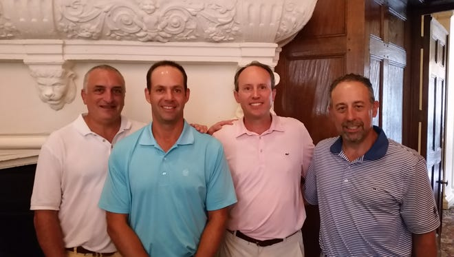 From left, Mill River Country Club's Larry Gellman, Brian Pendrick, Jason Caron and Michael Waters won the 72nd Hoffhine Memorial Pro-Am Tournament at the Westchester Country Club on Thursday after posting a team score of 135.