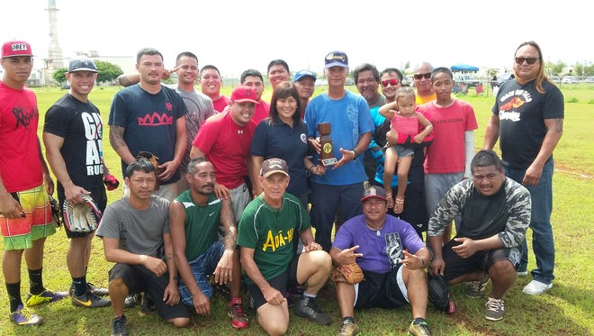 Bottoms Up won the inaugural Barrigada Municipal Planning Council Softball Tournament, defeating the Andersen Bombers for the title. Bottoms Up team members gather around the trophy they won presented by Barrigada Mayor June Blas.
