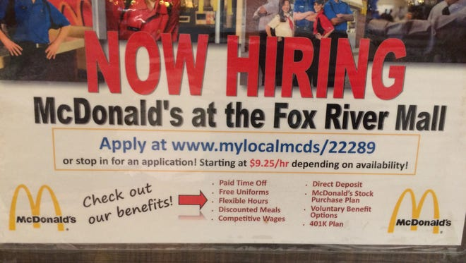 """Now hiring"" signs are plentiful in the Fox Cities these days, including this one at McDonald's at the Fox River Mall."