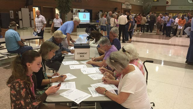 Visitors to an SCDOT public meeting at Greer High School leave comments on a roundabout proposed in Greer.