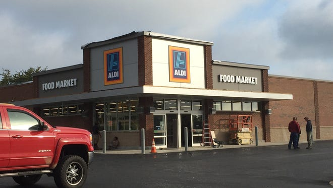 Workers put the finishing touches on a new Aldi grocery store opening later this month in Greer.