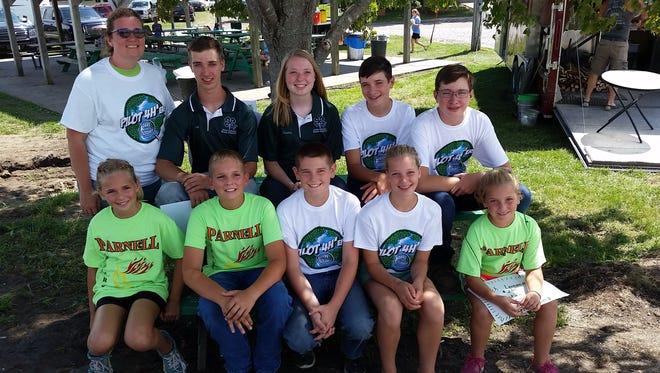 C. Elliott Driscoll's grandchildren all showed at the Iowa County Fair this past summer the fourth generation to do so. Front row (l-r): Erin Driscoll, Andy Driscoll, Jack Driscoll, Megan Heitman and Erica Driscoll. Back row: Leader Veronica Heitman, Ivan Heitman, Cassy Heitman, Carson Wendhausen and Caleb Wendhausen.