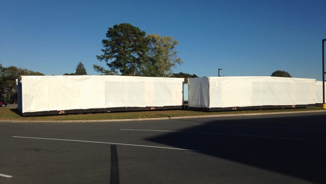This Oct. 21, 2015 photo is of portable structures about the length of a tractor trailer parked at Parkside High School in Salisbury. In all, about 15 portable structures are at the school and will accommodate students or other functions when renovations start next year.