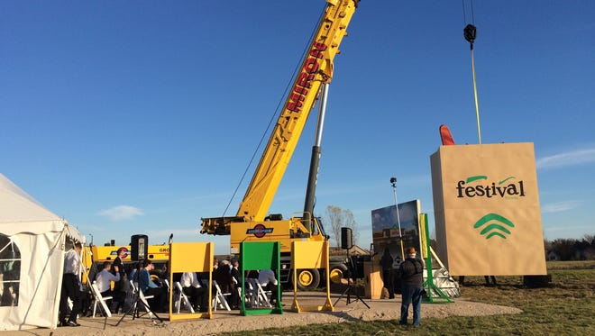 Festival Foods' groundbreaking in Menasha included a giant grocery bag prop.