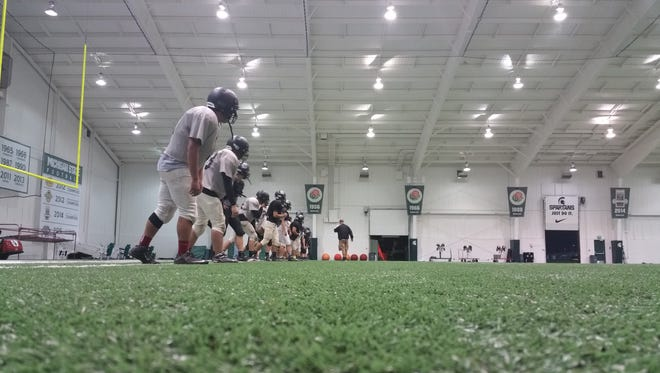 The Dansville football team practices Wednesday in East Lansing.